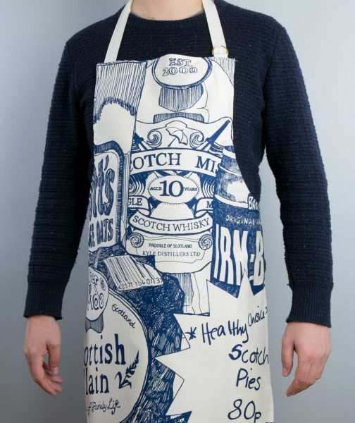Kitchen Tea Towel with Scottish Breakfast design by Gillian Kyle (on model)