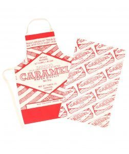 Kitchen Apron and Tea Towel with Tunnocks Caramel Biscuit Illustration by Gillian Kyle on model