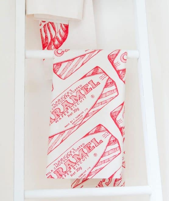 Kitchen Tea Towel with Tunnock's Caramel Wrapper Repeat illustration by Gillian Kyle (folded)