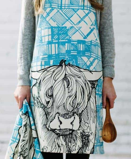 Kitchen Apron with Highland Cow Tartan Animals by Gillian Kyle on model
