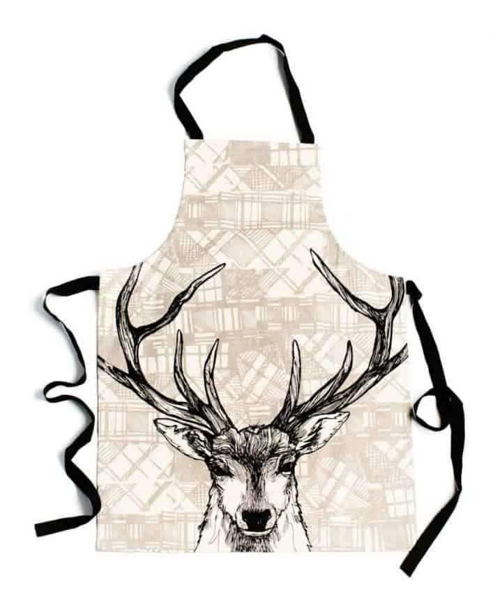 Kitchen Apron with Tartan Stag Animals by Gillian Kyle on model