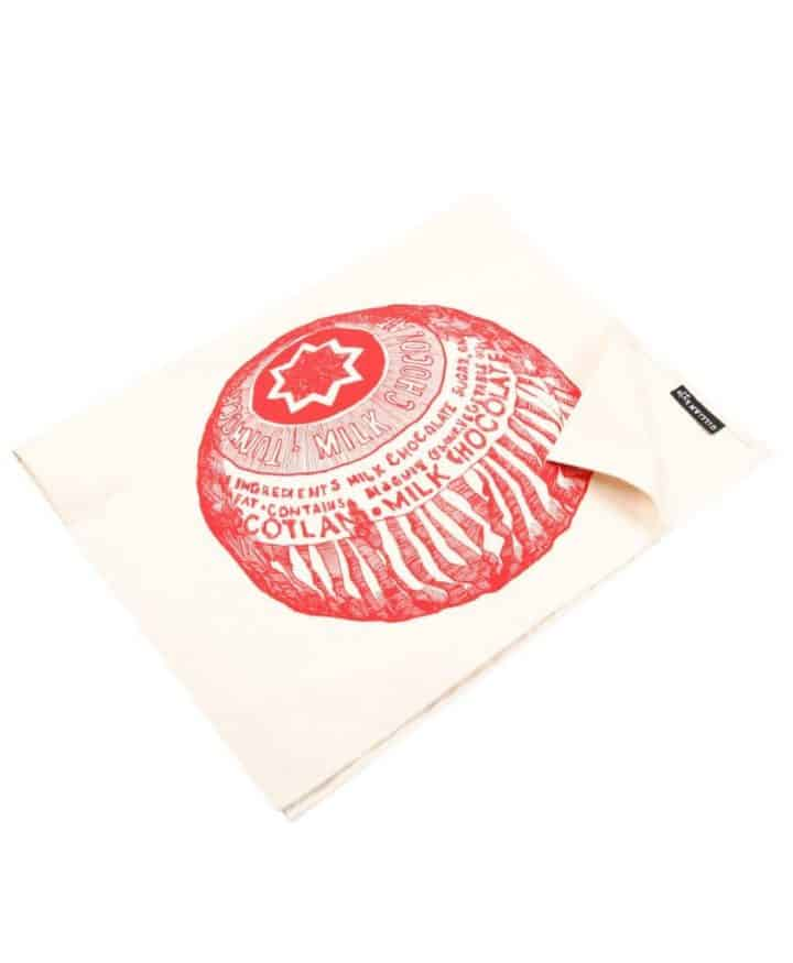 Kitchen Tea Towel with Tunnock's Teacake illustration by Gillian Kyle (folded)