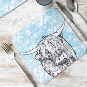 Highland Cow tablemats with tartan background by Gillian Kyle
