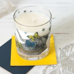 scented candle with highland cow by Gillian Kyle