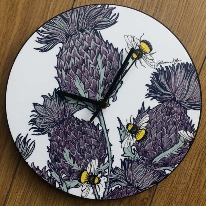 Scottish Thistles Wall Clock in red by Scottish designer Gillian Kyle