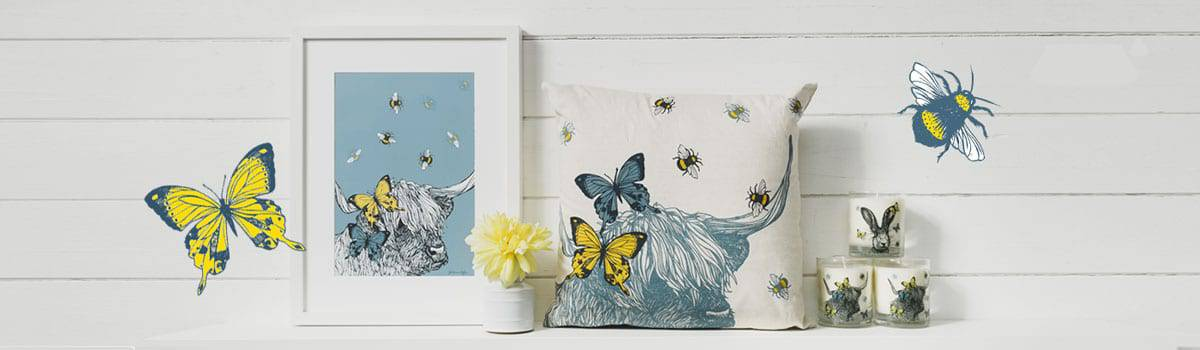 Spring interiors by Gillian Kyle - highland cow cushions, candles and art