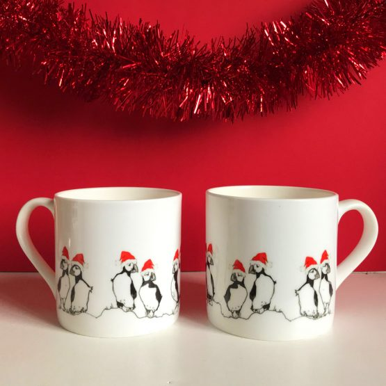 Christmas Puffin mugs by Scottish artist Gillian Kyle