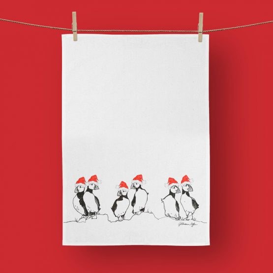 Christmas Puffin tea towels by Scottish artist Gillian Kyle