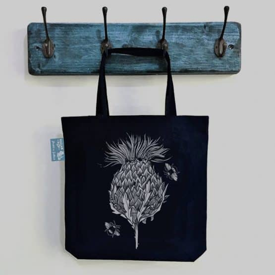 Flower of Scotland Scottish thistle fair-trade heavyweight cotton tote bag in black by Gillian Kyle
