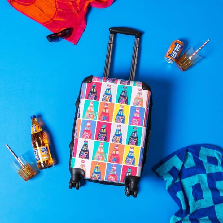 suitcases and luggage from POP! IRN-BRU merchandise range from Scottish artist Gillian Kyle